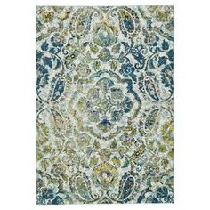 """Anchor your dining set or living room seating group with this artfully crafted rug, showcasing a paisley-inspired motif in azure.  Product: RugConstruction Material: PolypropyleneColor: AzureFeatures: Power-loomedPile Height: 0.4"""" Note: Please be aware that actual colors may vary from those shown on your screen. Accent rugs may also not show the entire pattern that the corresponding area rugs have.Cleaning and Care: Vacuum without a beater bar. Rug pad required."""