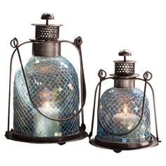 Set of 2 candle lanterns with mosaic glass detail.  Product: Small and large lanternConstruction Material: Glass...