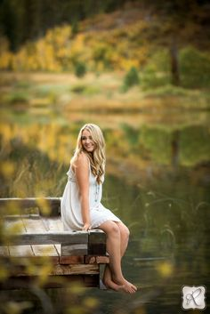 Beautiful outdoor senior pictures // sitting on a dock with bare feet in the water, amazing photo by Allison Ragsdale Photography