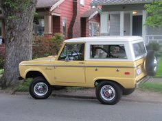 Yellow with white roof Ford Bronco Sports Utility Vehicles
