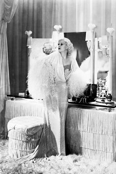 Maugham designed Jean Harlow's fringe-fantasy boudoir for Dinner at Eight. It was a marked moment for ultra-glamorous white interiors.