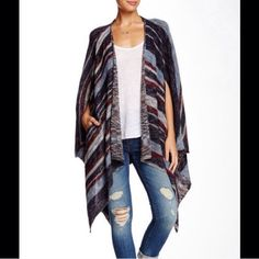 Free People poncho in Indigo Combo Stunning Free People poncho/cardigan. In Indigo Combo. NEW WITH TAGS! Originally $168. Size small, but could fit up to a large. Unique, flowy style. Perfect to pair with combat boots! No trades, PP, or discussing price in comments. Free People Sweaters Shrugs & Ponchos