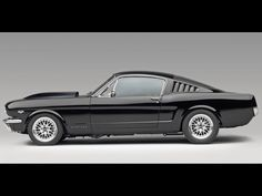 Mustang Fastback 69' This is what I wanted for my first car!!! Candy apple red with black racing stripes!!! Didn't happen!!! Lol...