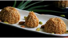 An unique version of modak made from vermicelli or seviyan and stuffed with finely chopped dry fruits Flour Dumplings, Modak Recipe, Indian Food Recipes, Ethnic Recipes, Dried Fruit, Ganesh, Pasta Noodles, Sweet Tooth, Dishes