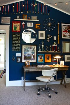 like the desk and notice the dark paint with gallery art