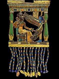 Elaborate gold coronation pectoral ornament from the tomb of King Tutankhamen, found inside one of the boxes in the treasury room. The central figure is the king himself with the khepresh crown and the crook and the flail in his hands. Ptah is facing the king and above his head is a cobra.