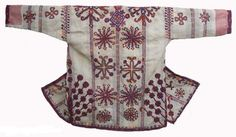 Afghanistan, men's jacket (shalai) with tree of life embroidered motif. Back view