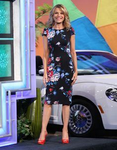 Navy blue dress w/abstract floral print in red, blue, green, pink, scoop neckline, cap sleeves, straight skirt | Vanna White's dresses | Wheel of Fortune