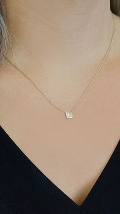 Split evenly between delicate diamonds and a contemporary sandblasted finish, this sleek and simple square necklace is just what your jewelry collection has been waiting for. #diamonds #necklaces #danarebecca