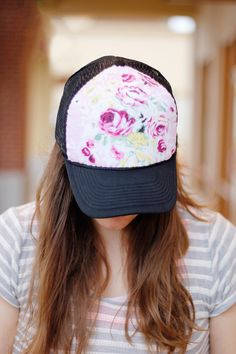 Pretty up a trucker or baseball cap by hand-stitching floral print fabric scrap across the panel. Tutorial is from See Kate Sew.