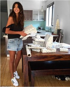 Getting prepared: Pia Miller shows off her long lean legs while wrapping Christmas presents for her family and friends