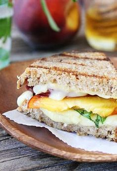 Grilled peach, brie and basil sandwich. I love this site http://porkrecipe.org/posts/Grilled-peach-brie-and-basil-sandwich-36317