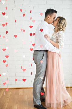 Shot at the fabulously fun Je T'aime Beauty Studio, this couple truly got in the spirit in this adorable Valentine's Day-themed engagement session from Kim Le Photography. Complete with cascading paper hearts, whimsical touches, and so much cuteness, click through the gallery here so