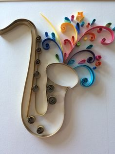 The Saxophone. Made by using the quilling technique. At the beginning my idea wa… Ideas Quilling, Paper Quilling Patterns, Quilling Paper Craft, Cardboard Box Crafts, Paper Crafts, Crafts To Sell, Diy And Crafts, Rolled Paper Art, Hand Embroidery Dress