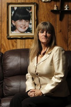 NOTABLE COLD CASES <=> Donna Norris poses next to a photo of her daughter Amber Hagerman, January 4, 2011, who was kidnapped 15 years ago while riding a bicycle near Norris mother's home in Arlington, Texas on January 13, 1996. (Richard W. Rodriguez/Fort Worth Star-Telegram/MCT via Getty Images)