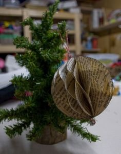 Here is one of the ornaments I have been working on the past few weeks. I was inspired by Zakka Life where they made a similar style orname. Paper Ornaments, Holiday Ornaments, Holiday Crafts, Holiday Fun, Christmas Holidays, Christmas Ideas, Christmas Decorations, Old Book Crafts, Book Page Crafts