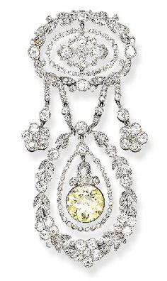 AN EXQUISITE BELLE EPOQUE DIAMOND AND FANCY YELLOW DIAMOND BROOCH, BY CARTIER. circa 1910