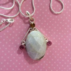"Natural Jade Pendant set in silver on silver Beautiful Natural Jade set in silver on a silver chain has a topaz and 2 pink tourmaline   The Jade is very light in Color more like an off white 22"" snake chain included Jewelry Necklaces"