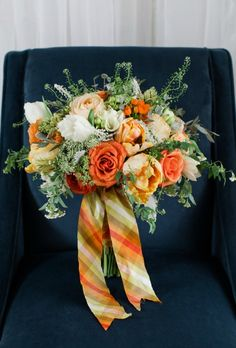 Maggie of Birds of a Feather Photography and Alicia Jayne Florals, Bridal bouquet of orange roses, peach parrot tulips, orange stars and que...