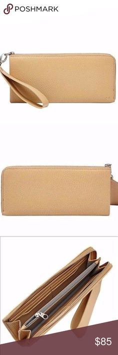✨NWT✨SKAGEN Hanne Zip-Around Wristlet Wallet 🇩🇰 ✨NWT✨SKAGEN Hanne Zip-Around Wristlet Wallet 🇩🇰 Color: Camel/Silver. NWT Condition w/VERY MINOR defect size of a pen tip on detachable strap(Please refer to last photo). Price reflects minor defect. A streamlined wallet crafted in smooth leather channels. Optional wrist strap makes for savvy hands-free style. Detachable wrist strap Zip-around closure Interior features zip, wall, and currency pockets and six card slots Leather construction…