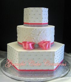 Elegant Whte Wedding Cake with Coral Ribbon and Bling
