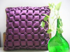 Purple satin designer cushion cover with Canadian smocking work  and a contrast golden back. http://knotnstitch.blogspot.in/2013/08/designer-cushion-covers-for-your-home.html