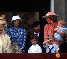 June 15, 1985: A nine-month old Prince Harry with members of the Royal Family on the balcony at Buckingham Palace for Trooping the Colour in London. This was his first appearance on the balcony.
