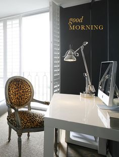 Love this leopard chair paired with sleek white parsons desk
