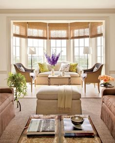 Bay windows let the light shine into these beautiful interiors from our archive