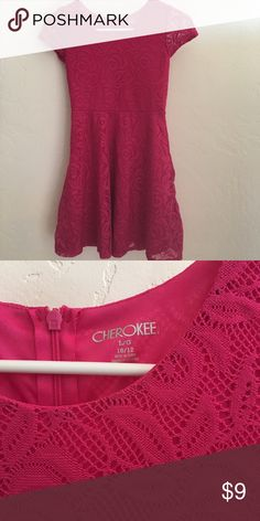 Cherokee pink lace cap skater style dress L 10 12 Girls size large pink skater dress by Cherokee. Cap sleeve skater cut style. Outer is lacelike with built in pink lining/slip. Perfect for travel or the school year. As the dress is not prone to wrinkling. From my smoke free home. Please ask all questions prior to purchase as all sales are final. Cherokee Dresses Casual