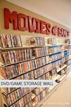 """DVD-Game Storage Wall"" -- Click through to see the whole room renovation."