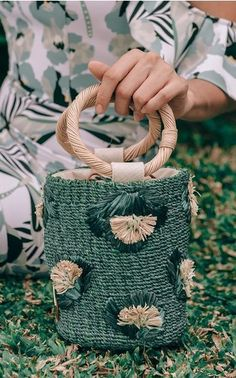 Far from your average beach bag, Filipino mother-daughter design trio Becky, Amina and Rosanna Aranaz's line of artisanal pieces includes luxurious, wood-carved florals, raffia bucket bags and colorful totes embroidered with flamingoes and dragonflies.