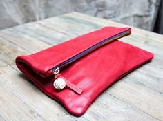 Spartan red leather clutch