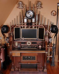 Steampunk gigantic pipe organ upon which computer workstation is set up.