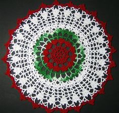 Here is the website where i found the pattern for this doily.  I just changed the colors to make it look a little different. http://pandacrochet.8m.com/exchngdoily.html Other topics you may enjoy:La Fleur Doily BagChunky Doily RugDoily PillowCrochet Sun-Flower DoilyPassion Flower Doily