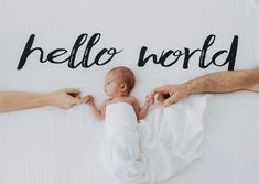 The sweetest little birth announcement using Modern Burlap's 'Hello World' swaddle blanket #newbornbabyphotography