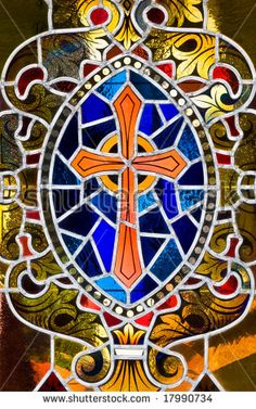 A stained glass rendition of a cross.
