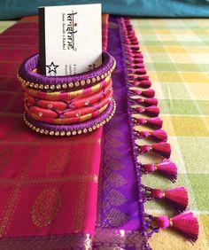 Get Your Silk Sarees Embellished With Cute Tassels Saree Tassels Designs, Saree Kuchu Designs, Pattu Saree Blouse Designs, Cutwork Blouse Designs, Embroidery Neck Designs, Thread Bangles Design, Silk Thread Bangles, Hand Work Blouse Design, Bridal Silk Saree