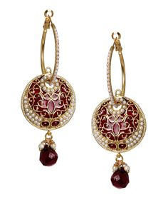 Dripping Traditionality. Ethnic Golden Jhumka completes a girl attire.