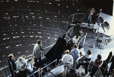 Crew on Bespin set witnessing Vader and Luke duel.