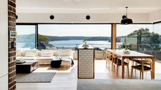 Vast, panoramic views are the feature of this open-plan living space. Photo – Mitch Fong.