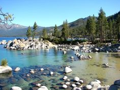 The crystal-clear waters of Lake Tahoe's Sand Harbor Beach are among the most popular Nevada swimming spots. Sand Harbor's secluded Diver's Cove bay offers shade from the trees and huge rocks for diving