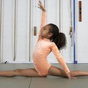The split is a very advanced flexibility exercise involving one leg straight out in front of you and the other straight behind you on the floor. Dancers and gymnasts use this stretch to greatly improve their flexibility and leg extensions. No matter what your type of activity is, however, stretching on a regular basis improves muscular mobility and...