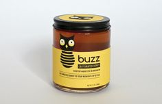 """Buzz Caffeinated Honey: Buzz Caffeinated Honey is a fictional brand of NYC Rooftop Honey. The concept for the company is derived from New York's nickname """"The City That Never Sleeps."""" Buzz Caffeinated Honey is made for NYC night owls looking for that extra boost of caffeine in their midnight cups of tea. The logo of the company juxtaposes the head of a """"night owl"""" with the shape of a beehive."""