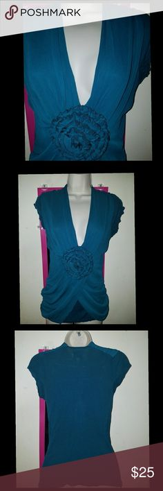 Deletta Anthropologie Teal Rosette Blouse Beautiful teal colored chiffon blouse from Deletta. V neck with a large rosette. Front is draped. Chiffon is sewn onto a stretchy knit fabric, like a t shirt. Short sleeves. Size small. Bust 34 inches unstretched. Length 27 inches at longest point. EUC. Anthropologie Tops Blouses
