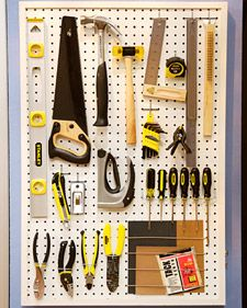 great way to hang and show the tools of our trade(s). easy to access, easy to store. and looks cool.