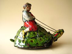Fabulous boy on turtle tin toy from the 1920s in Germany. Available from http://www.hollandtoys.com