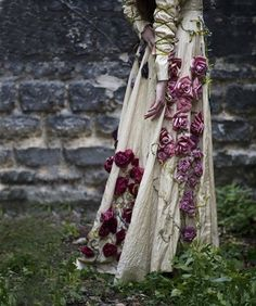 """The Victorian Era is very inspirational with its romantic themes of femininity and elegance.  Using Victorian gowns covered with greenery and live flowers like this photo would be ideal to use for a womenswear retailer for spring 2012.  It would incorporate the """"green"""" trend and going back to nature."""