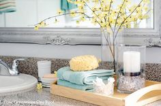 I love the tray with flowers and a place to keep extra hand towels.  Very cute!!!