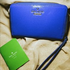 """KATE SPADE Lacey Cedar Street Wallet wristlet New authentic patent leather❤️❤️❤️ retail tag is not attached as this was a gift.  6.4"""" x 3.8"""" x .5"""" Patent Leather Zip around closure Wristlet strap measure 5.75 inches Interior features 7 credit card slots and 3 large slip pockets Back features exterior zip pocker Gold tone hardware details Logo on front kate spade Bags Wallets"""